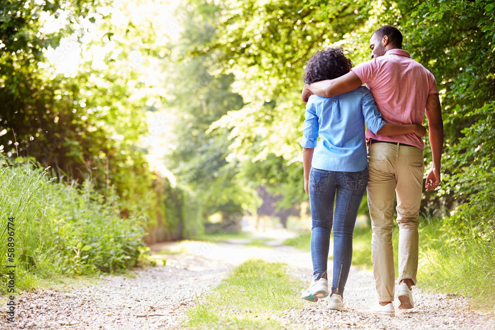 Fototapety, obrazy: Young African American Couple Walking In Countryside