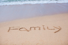 Family Painted In The Sand On A Tropical Beach