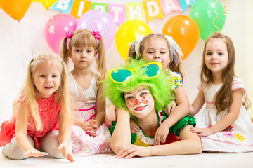 jolly children and clown on birthday party