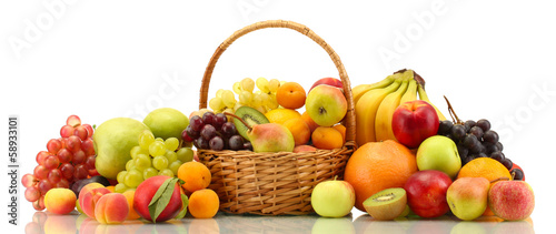 Tuinposter Vruchten Assortment of exotic fruits in basket isolated on white