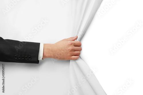 Fotografía  hand turns paper