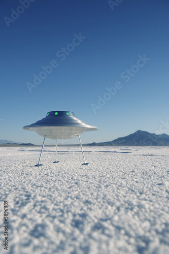 Foto op Canvas UFO Silver Metal Flying Saucer UFO Harsh White Desert Planet