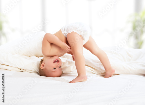 Tableau sur Toile happy baby child playing   in bed