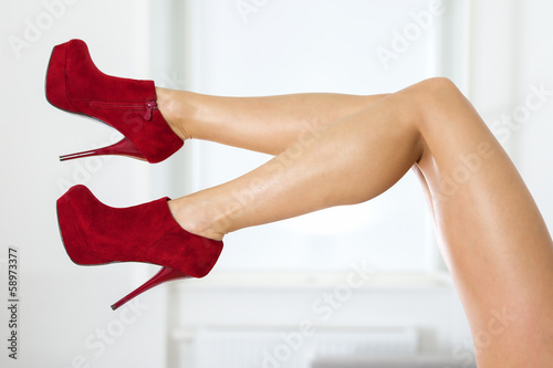 32f477a447e2 Legs of a woman wearing fishnet stockings and red ankle boots - Buy ...