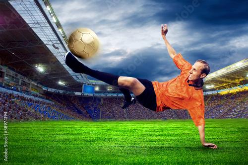 Staande foto Voetbal Football player on field of stadium