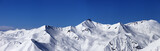 Panoramic view on off-piste slopes and blue sky at nice day