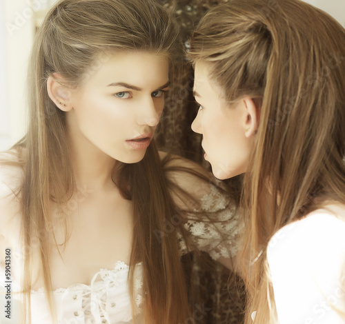 Fényképezés  Delusion. Image of Beautiful Woman in Front of a Mirror