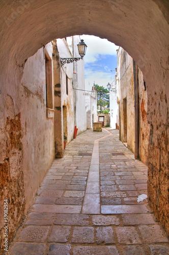 Fototapeta Alleyway. Presicce. Puglia. Italy.