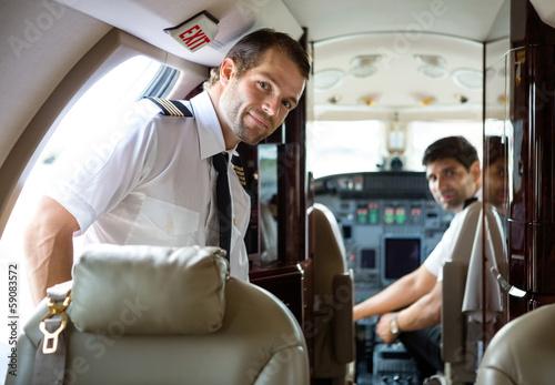 Fotografija Pilot Entering Private Jet