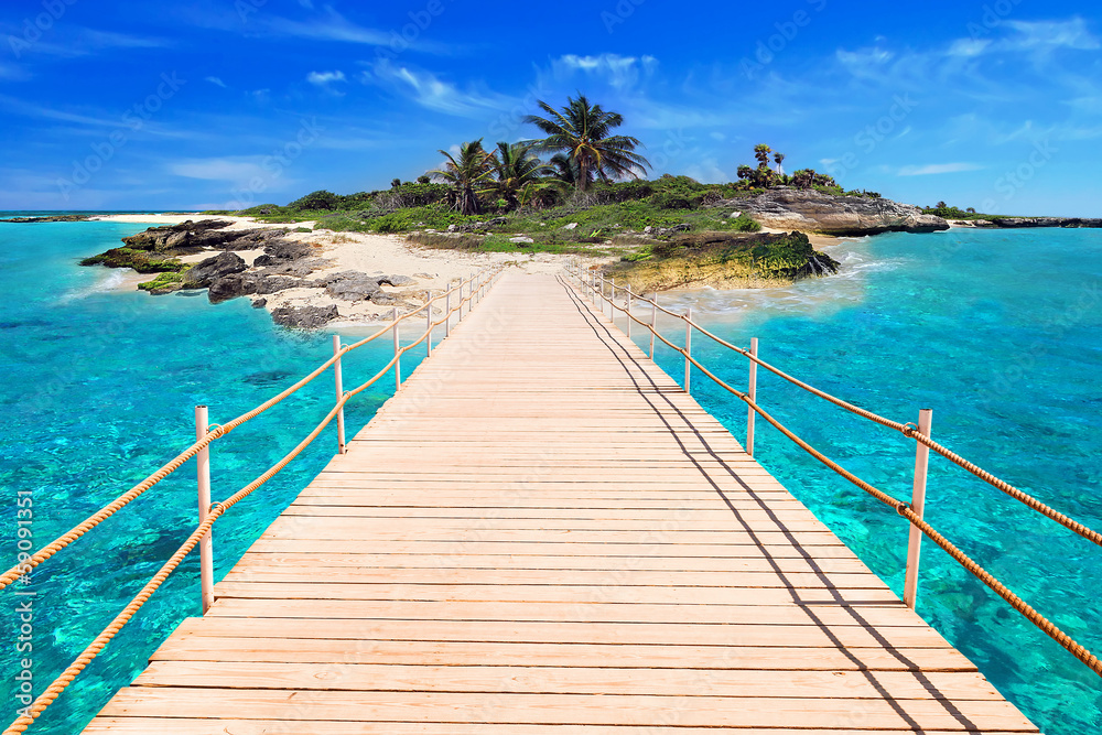 Fototapeta Pier to the tropical island of Caribbean Sea