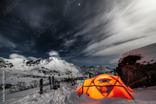 Poster Camping Tent among winter mountains. Stock image