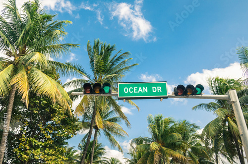 Ocean Drive in Miami - Road sign and green Traffic Light