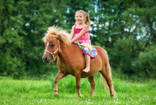 Little Girl Riding Little Pony