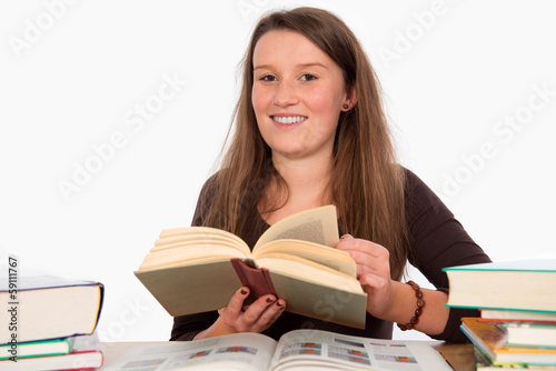 Foto  young woman with books is smiling
