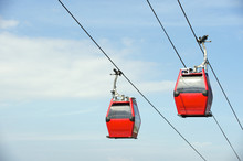 Red Overhead Cable Cars Blue Sky
