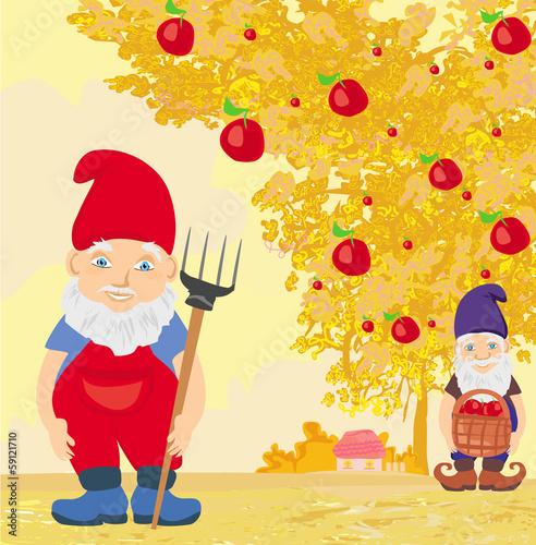 In de dag Regenboog two dwarfs and apple tree in autumn