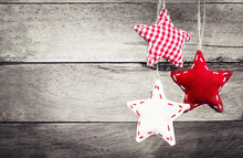 Christmas Decoration Hanging Over Rustic Wooden Background. Vint