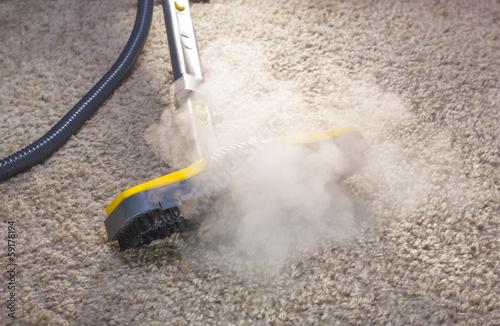 Fototapeta Dry steam cleaner in action. obraz