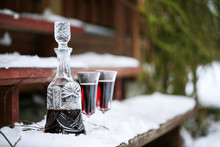 Decanter And Wineglasses Of Red Wine Outdoors