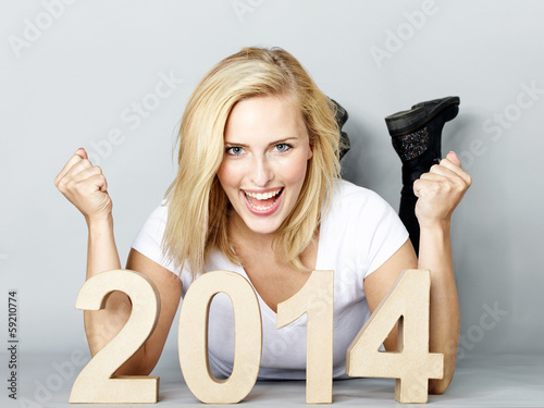 Woman presenting the New Year 2014 Canvas Print