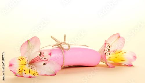 Fototapeta Two flowers of alstromeriya and fragrant soap obraz na płótnie