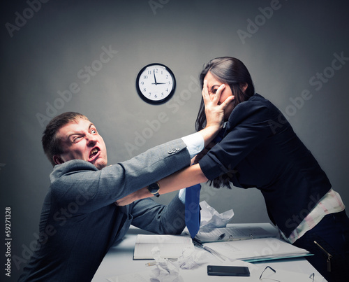 Valokuva  Two young caucasian office worker starting to fight