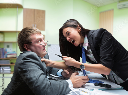 Fotografie, Tablou  Two young caucasian office worker starting to fight