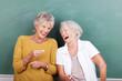 canvas print picture - lachende seniorinnen vor einer schultafel