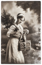 Young Woman With Christmas Tree And Gifts