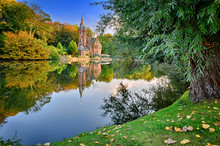 Autumn Landscape With Lake And Old Mansion