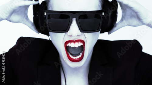 Dramatic portrait of a woman in headphones