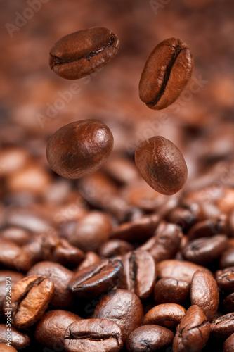 Fototapeta four falling coffee beans and roasted coffee obraz na płótnie