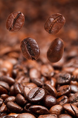 Fototapetafour falling beans and dark roasted coffee
