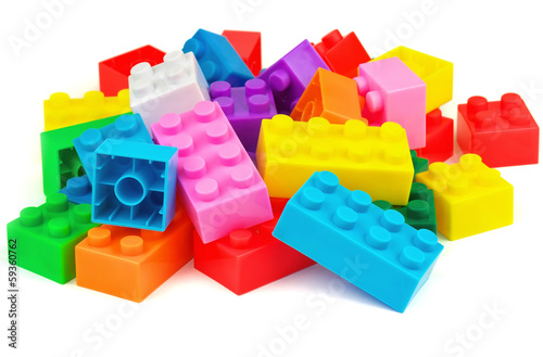 Fotografie, Obraz  Plastic colorful toy blocks on white background