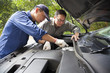 Auto mechanic fixes a car in service