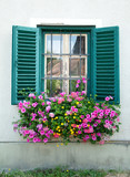 wooden window decorated with flowers
