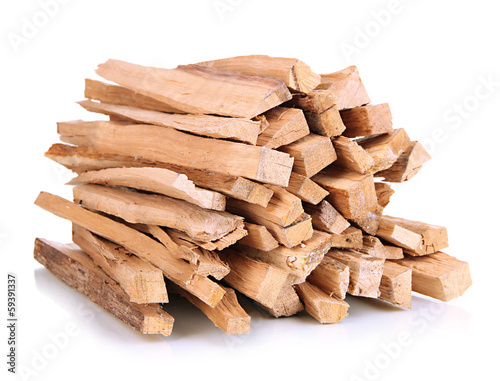 Fotografia Stack of firewood isolated on white