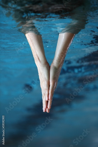 Foto op Aluminium Flamingo two hands together surfaced from water, V - shape sign