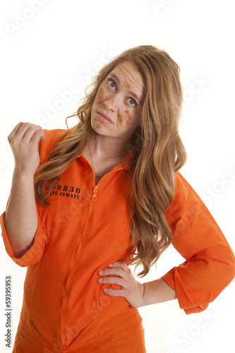Photo Woman inmate dirty hold up hand