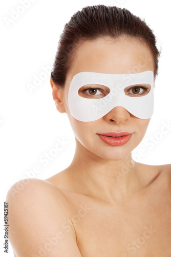 Fotografie, Obraz  Beautiful woman with collagen mask on eyes.