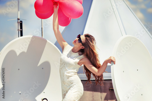 Fotografie, Obraz Beautiful happy girl with red balloons on the roof