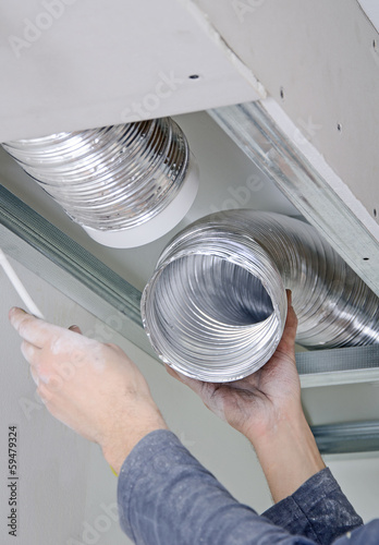 Photo Male hands setting up ventilation system indoors