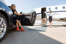 Wealthy Woman Stepping Out Of ...