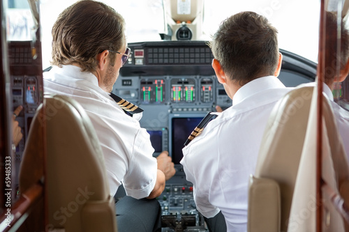 Pilot And Copilot In Private Jet Cockpit Tapéta, Fotótapéta