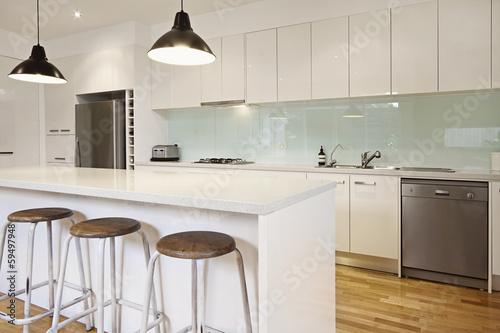 Fototapeta White contemporary kitchen with island obraz