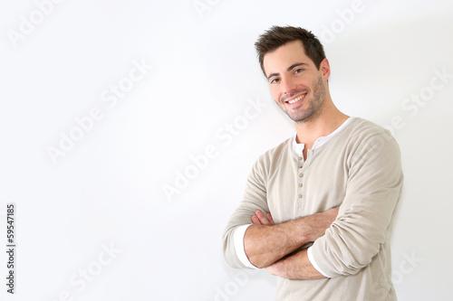 Valokuva  Handsome guy standing on white background