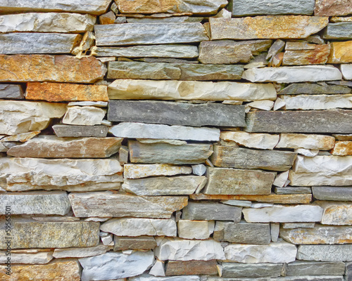 Tuinposter Stenen marble and stone wall closeup