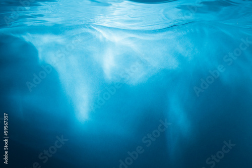 Abstract blue background. Water with sunbeams