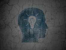 Marketing Concept: Head With Light Bulb On Grunge Wall