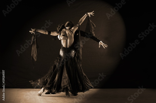 Fotografie, Obraz  Latino dancers in ballroom against white background
